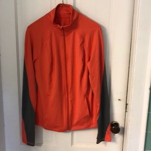 Nylon athletic wear jacket in salmon and grey